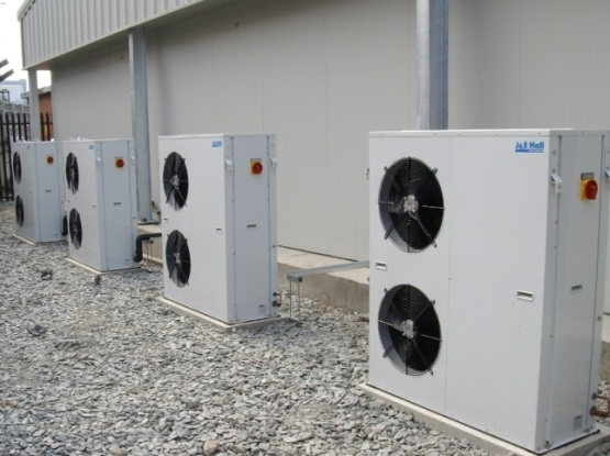 view of 4 J&E Hall air condition units outside a building.