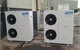 two J&E Hall air conditioning units installed outside building.