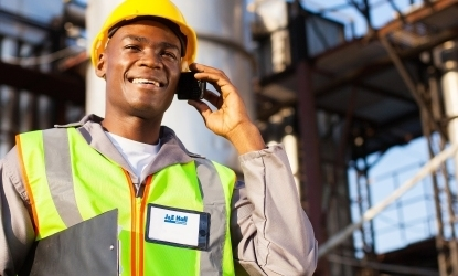 view of a man in hi-vis gear on the phone used on J&E Hall's energy solutions page.