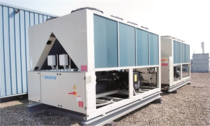 view of daikin refrigeration unit on the roof of a building.