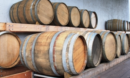 wooden barrels in storage to showcase J&E Hall's ambient beer cooler product page.